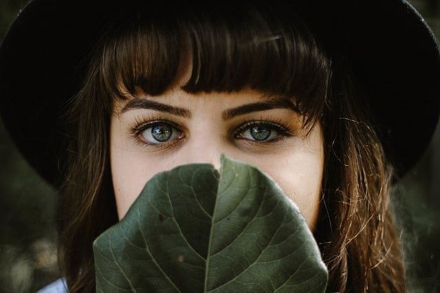 A close up of a girl with green eyes
